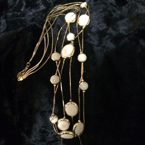 Gold necklace with cream colored beads